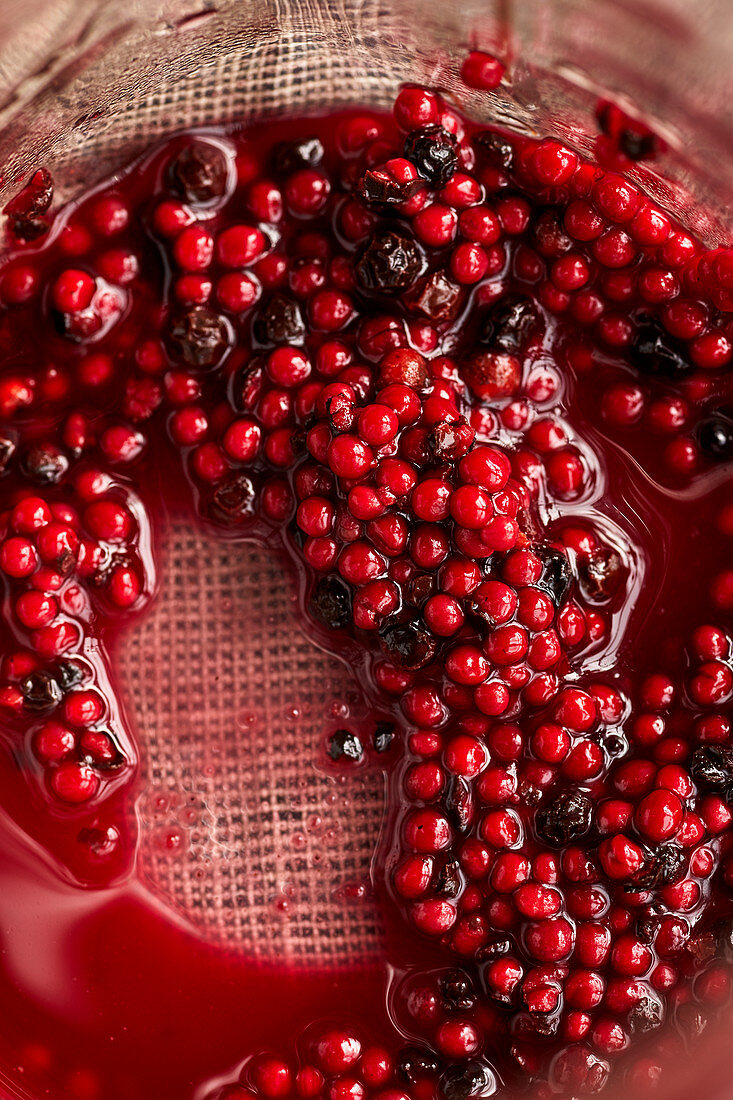 Mustard seeds and peppercorns preserved in beetroots juice