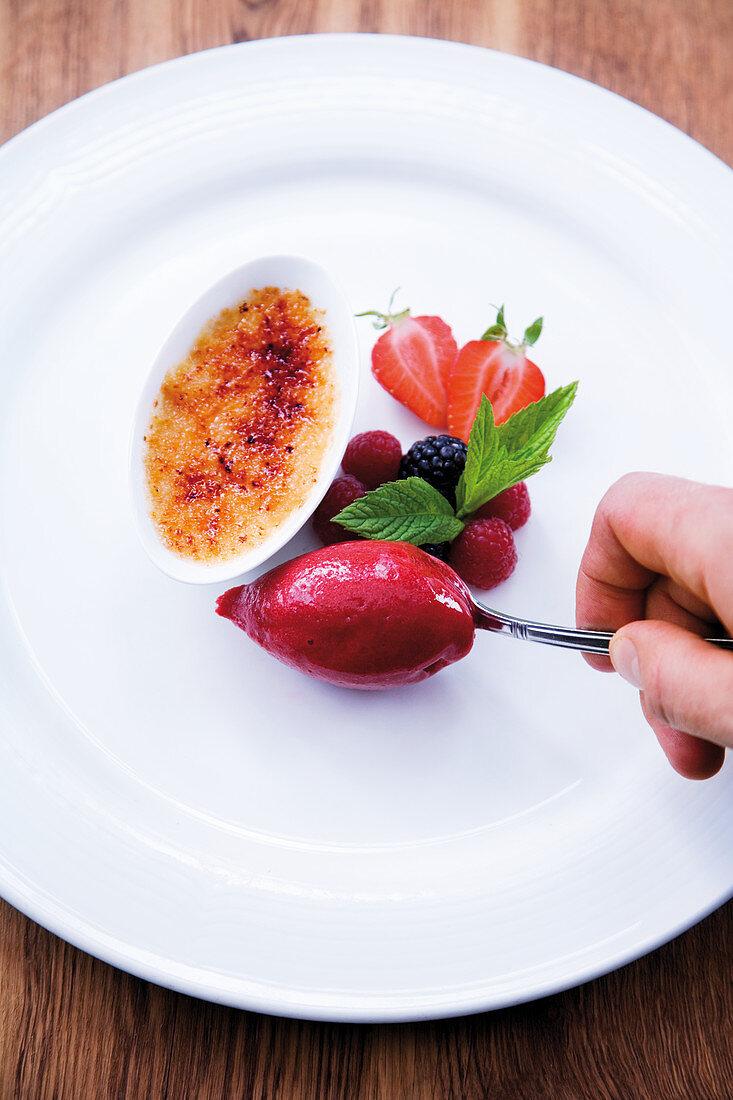 Caramelised mocha chocolate cream with raspberry sorbet