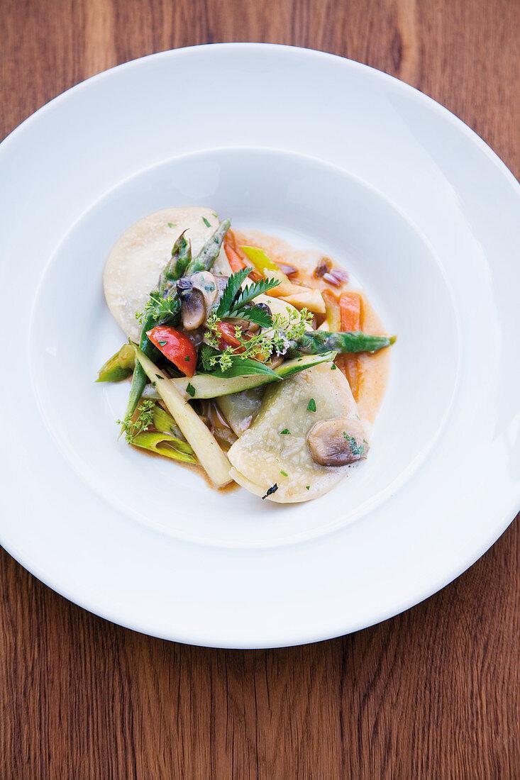 Wild herb ravioli with glazed spring vegetables