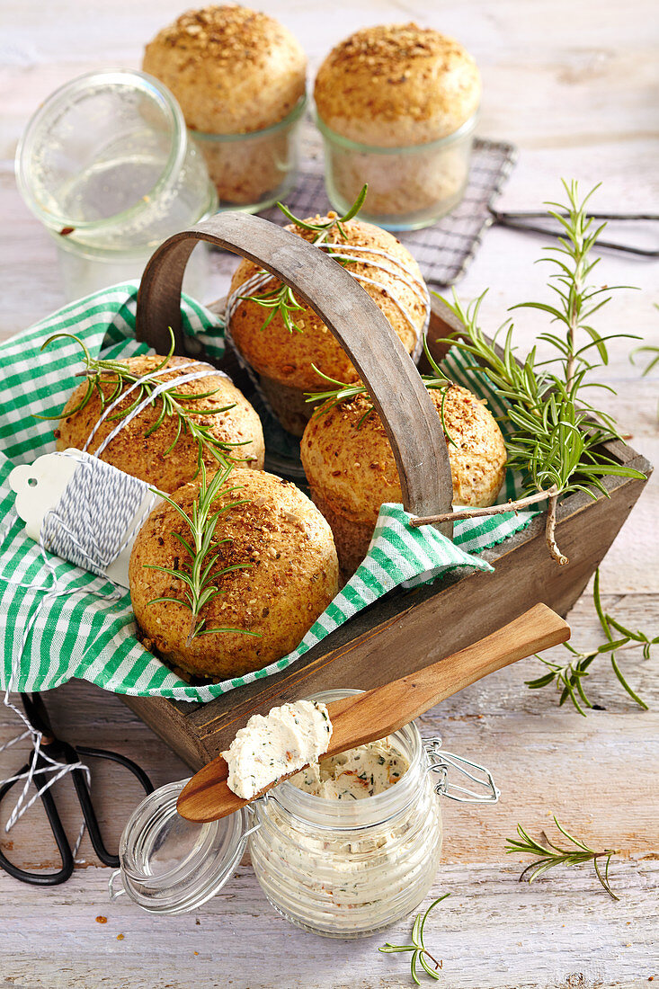 Easter buns made from spelt yeast dough with rosemary served with a cream cheese, tomato and herb dip