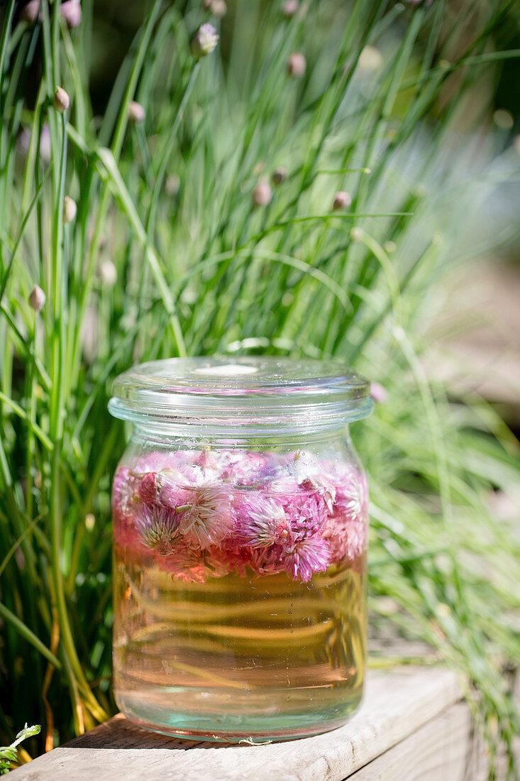 Jar of chive-flower vinegar