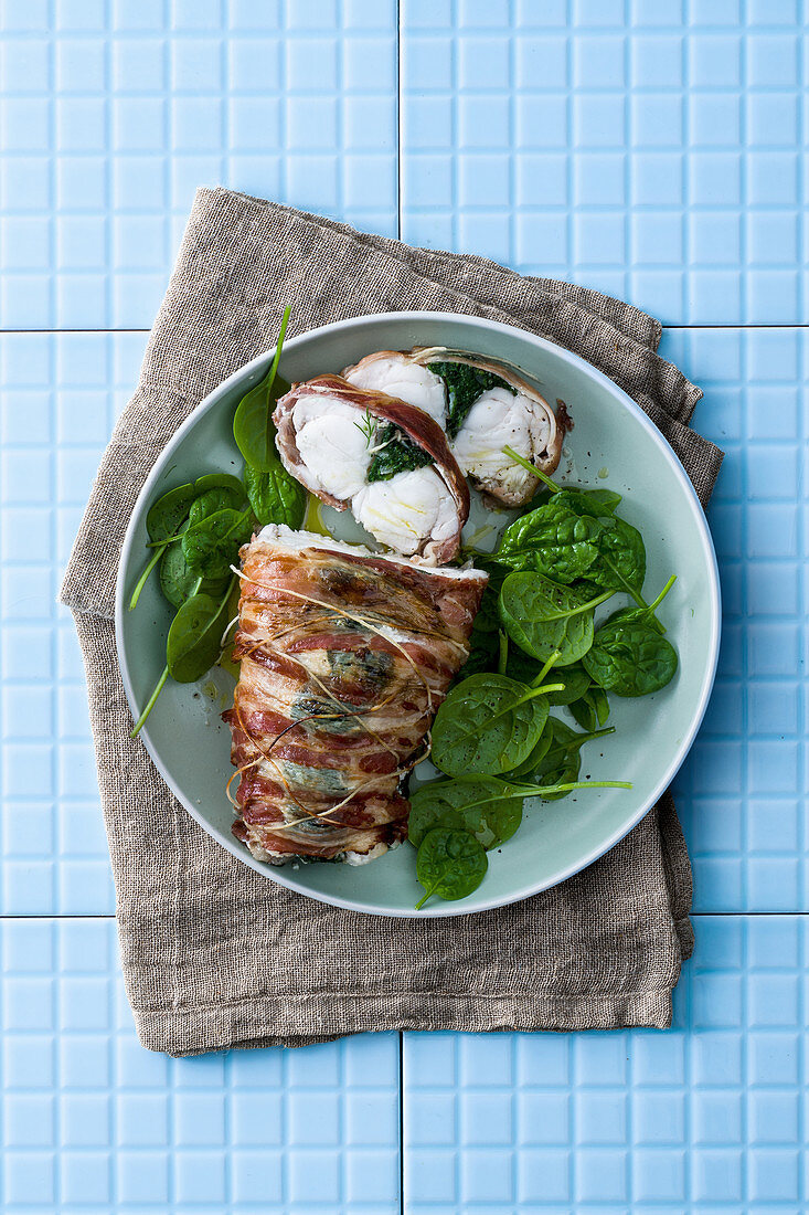 Monk fish with spinach wrapped in bacon