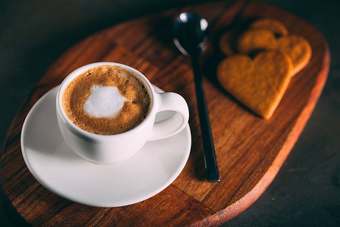 Coffee cup with hearth shaped biscuits