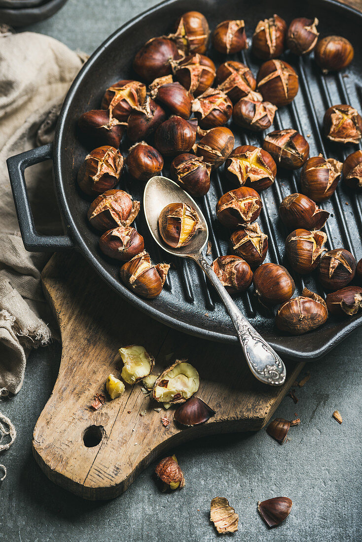 Roasted chestnuts in cast iron grilling pan