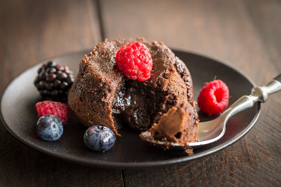 Chocolate cake with a liquid core and berries