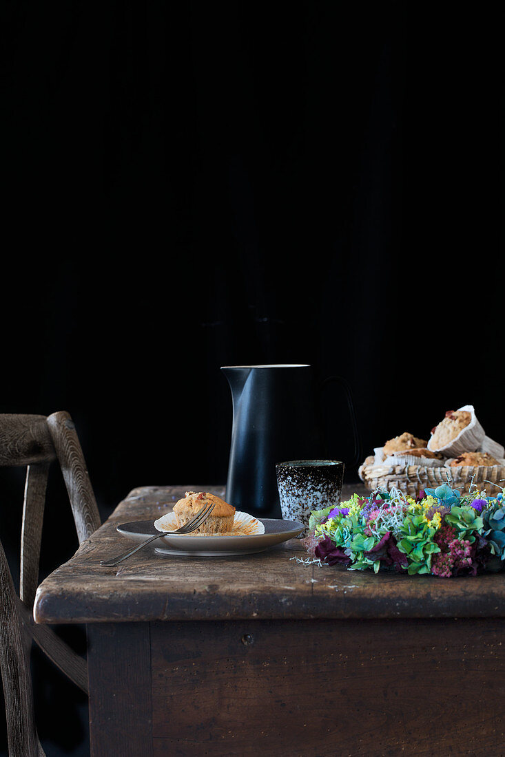 Wholemeal muffins on a wooden table with autumnal decoration