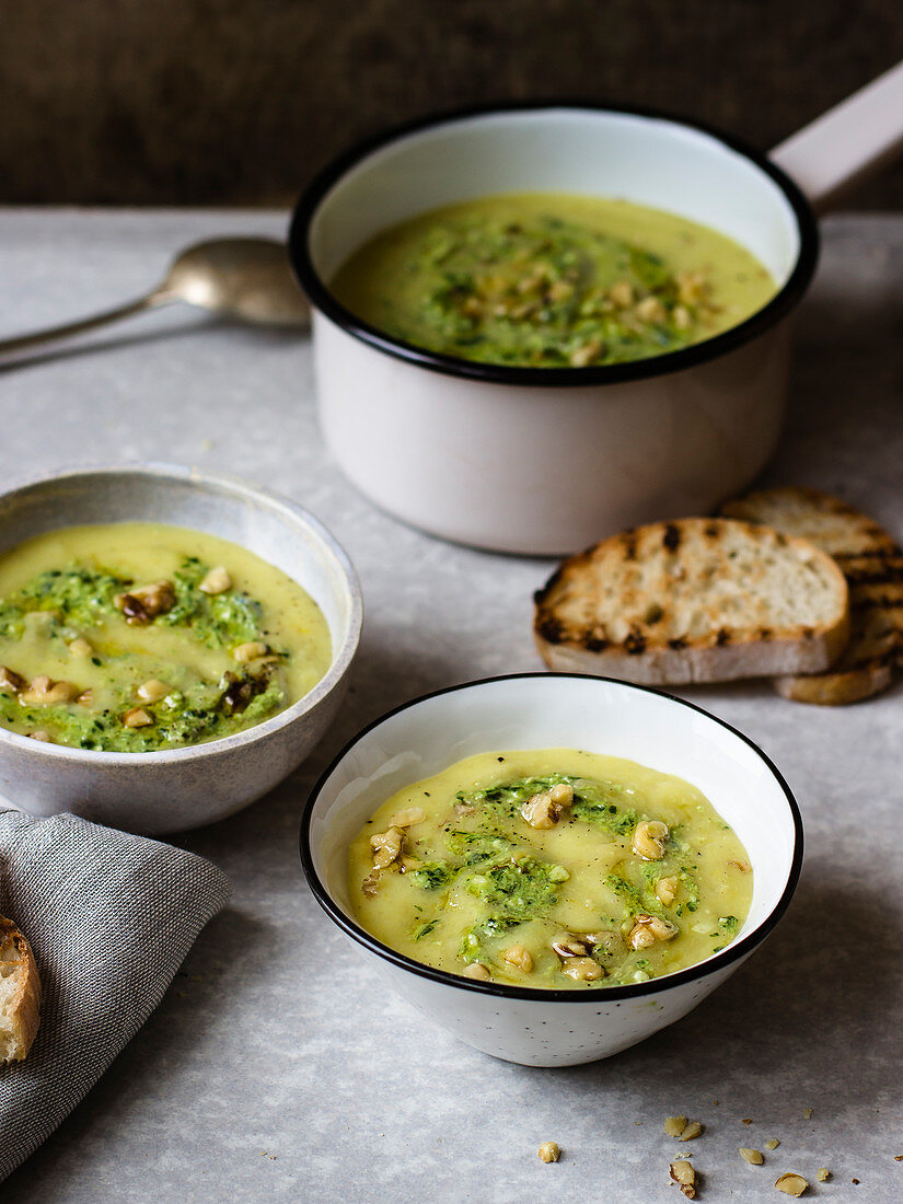 Potato and leek cream soup with parley pesto and walnuts