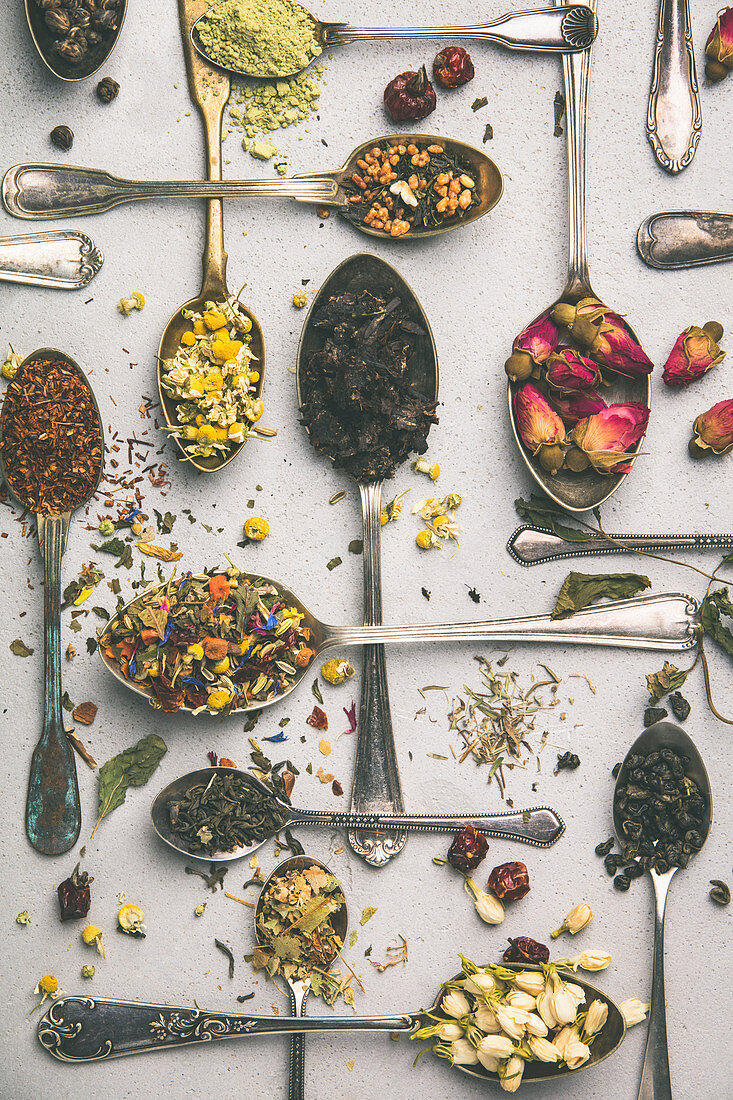 Assortment of dry tea in vintage spoons