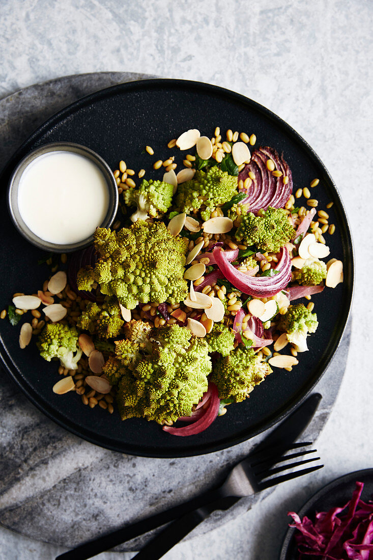 Roasted romanesco cauliflower salad with roasted red onions and ancient grains (roasted farro)