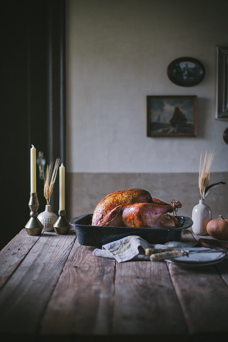 A roasted Thanksgiving holiday turkey on a dining room table