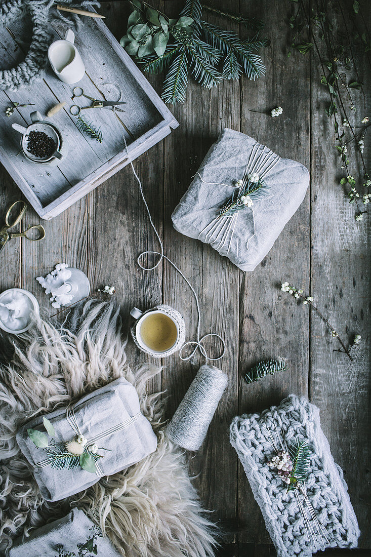 Wrapped Christmas gifts and tea