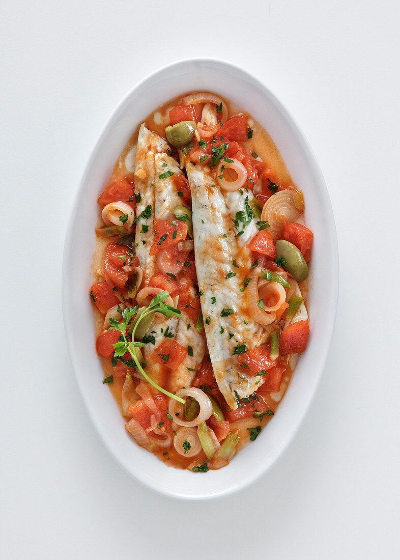 Branzino all'acqua pazza con olive e peperoni (bass fillets in a white wine and vegetable broth, Italy)