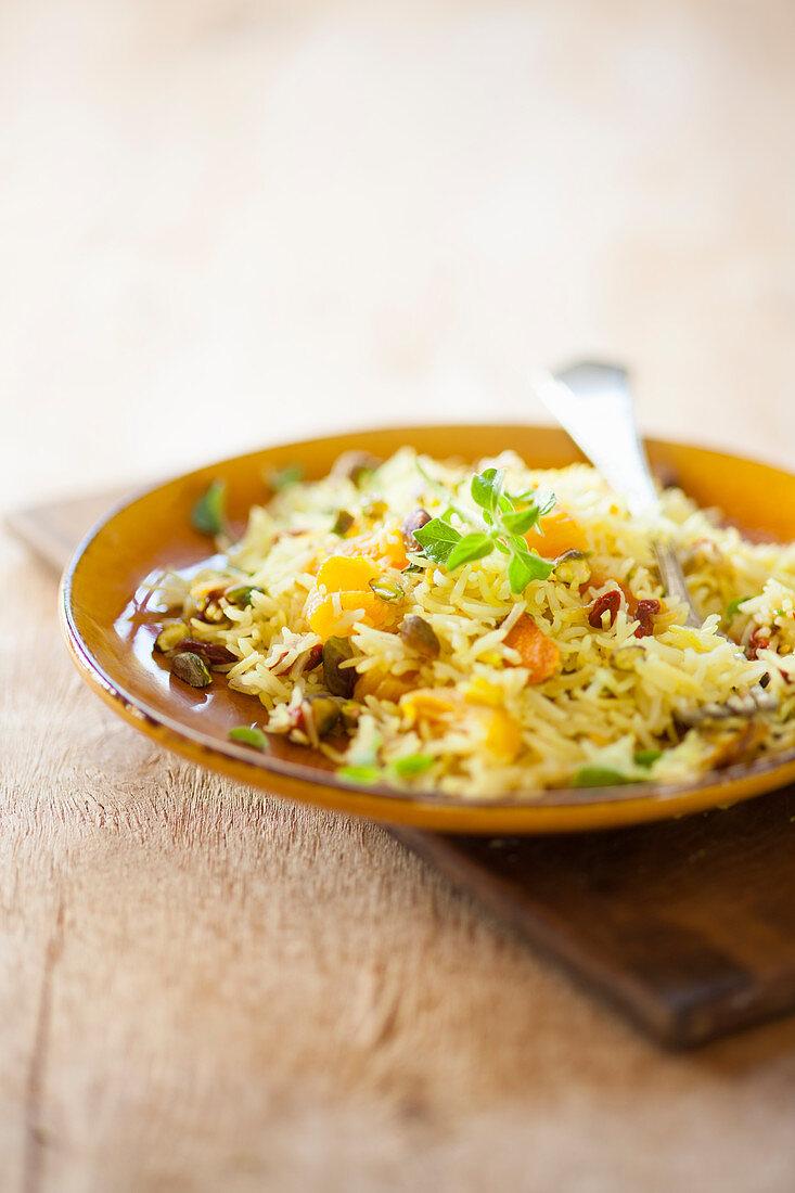Yellow biryani (roasted rice, asia) with oranges