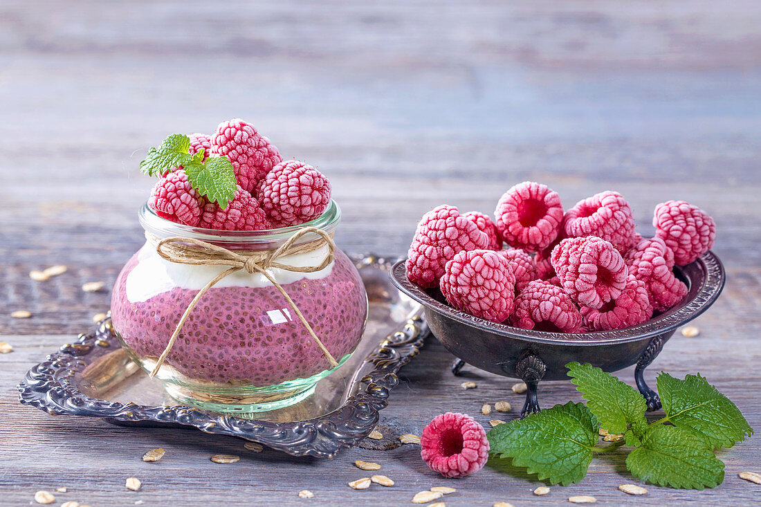 Acai chia pudding with frozen raspberries and mint leaves