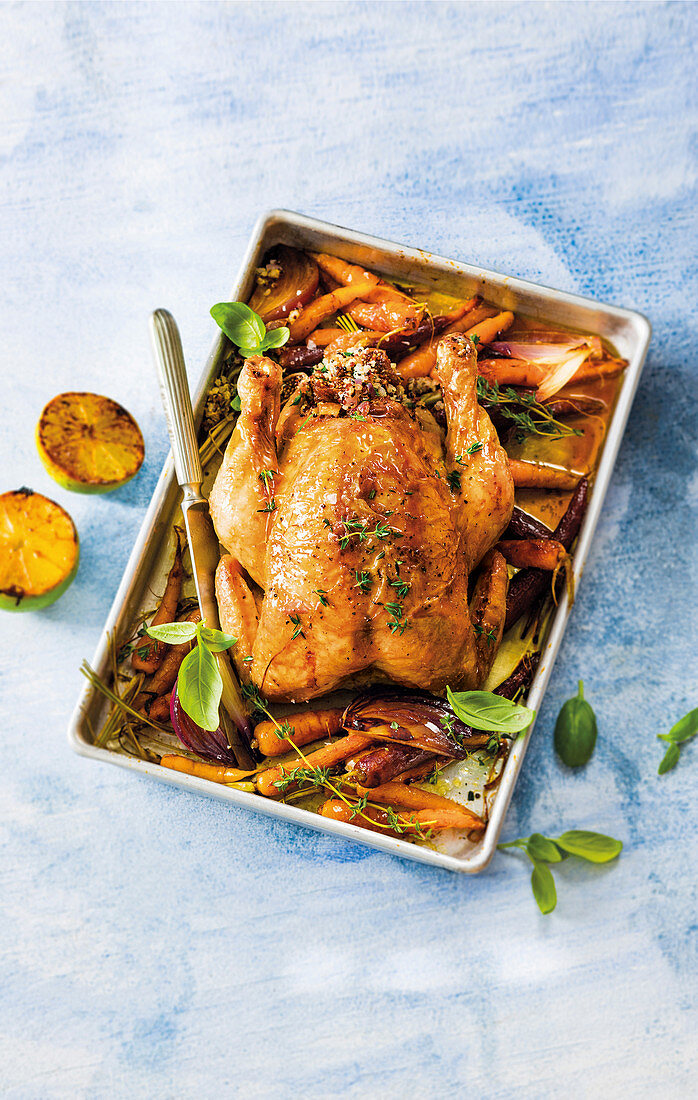 Roast chicken with quinoa, herbs and dried fig stuffing
