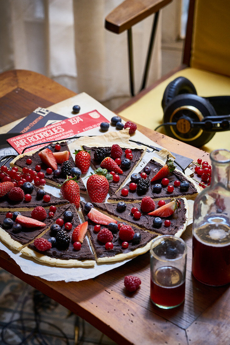 Chocolate pizza with berries for a retro party