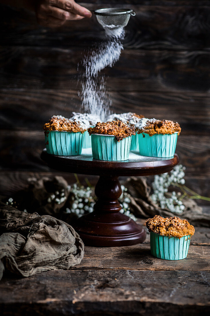 Rustic banana muffins with a dusting of powder