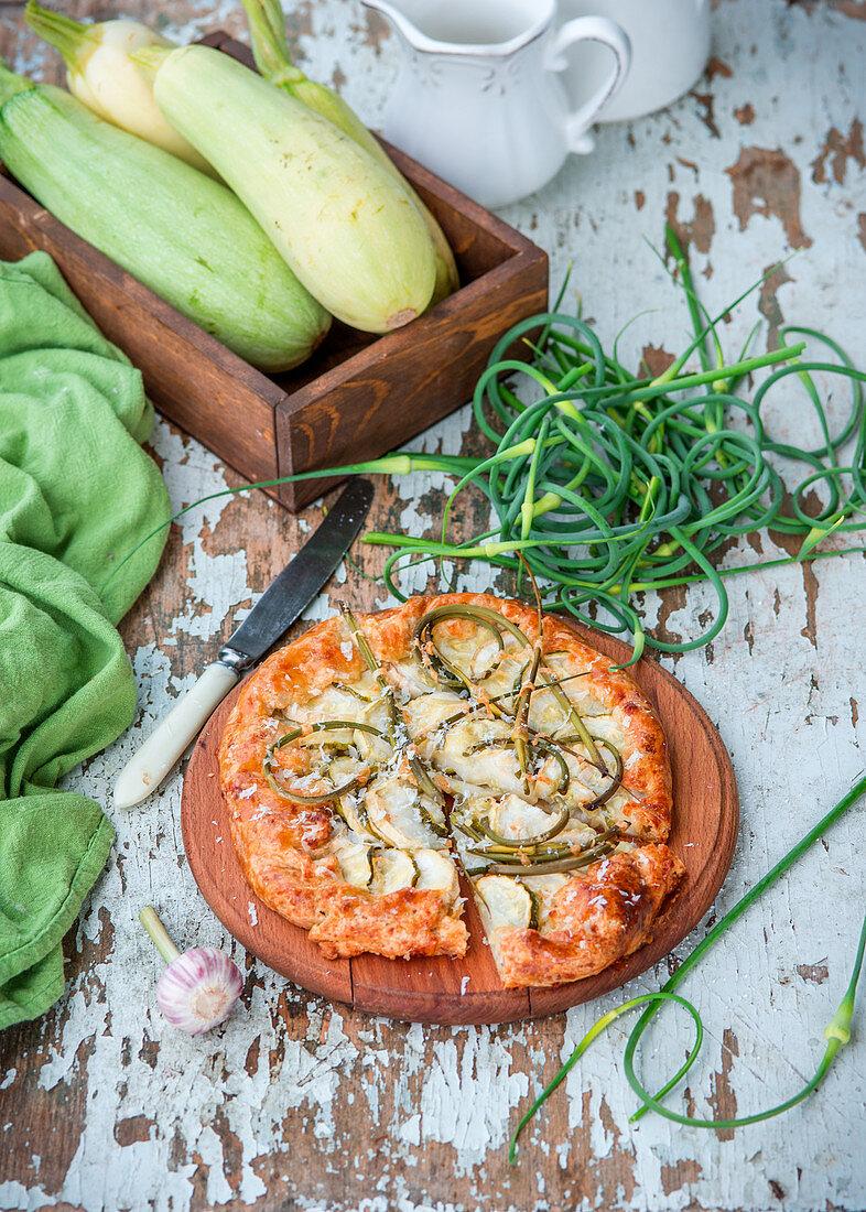 Garlic shoots and zucchini pie