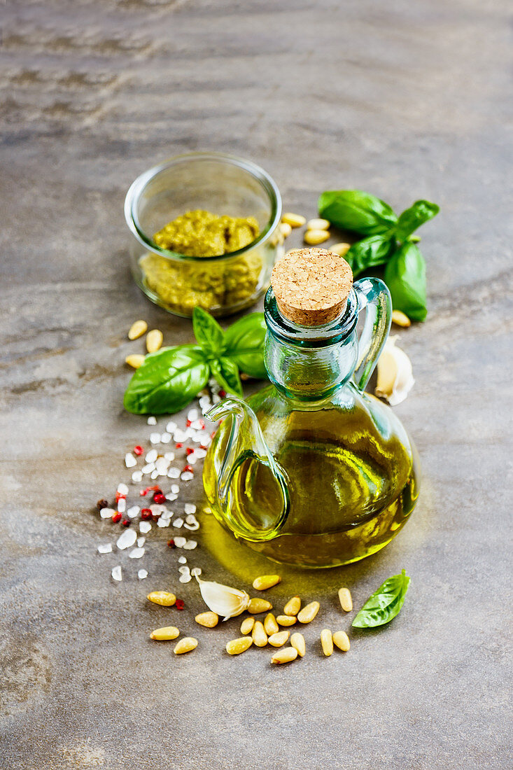 Italian pesto sauce ingredients on vintage background