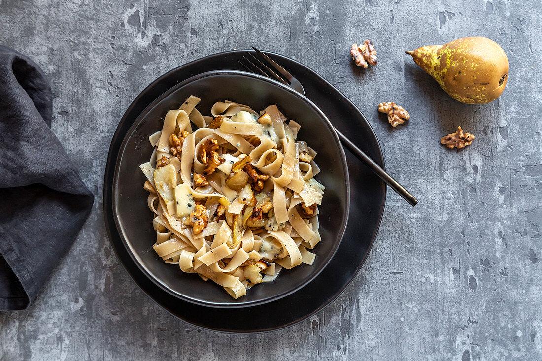 Spelt tagliatelle with balsamic pears, gorgonzola, walnuts and cashew nuts
