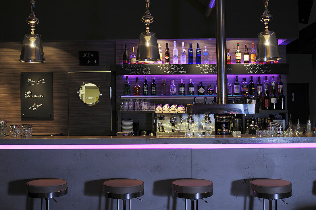 The interior of a bar with dim lighting