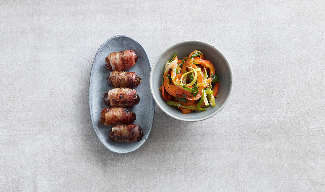 Grilled bacon dates with a pepper salad