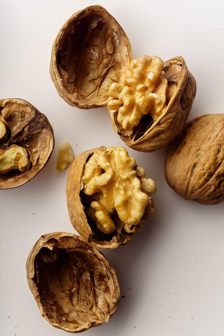 Raw walnuts with cracked nutshells