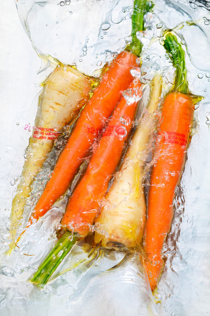 Sous vide root vegetables in water