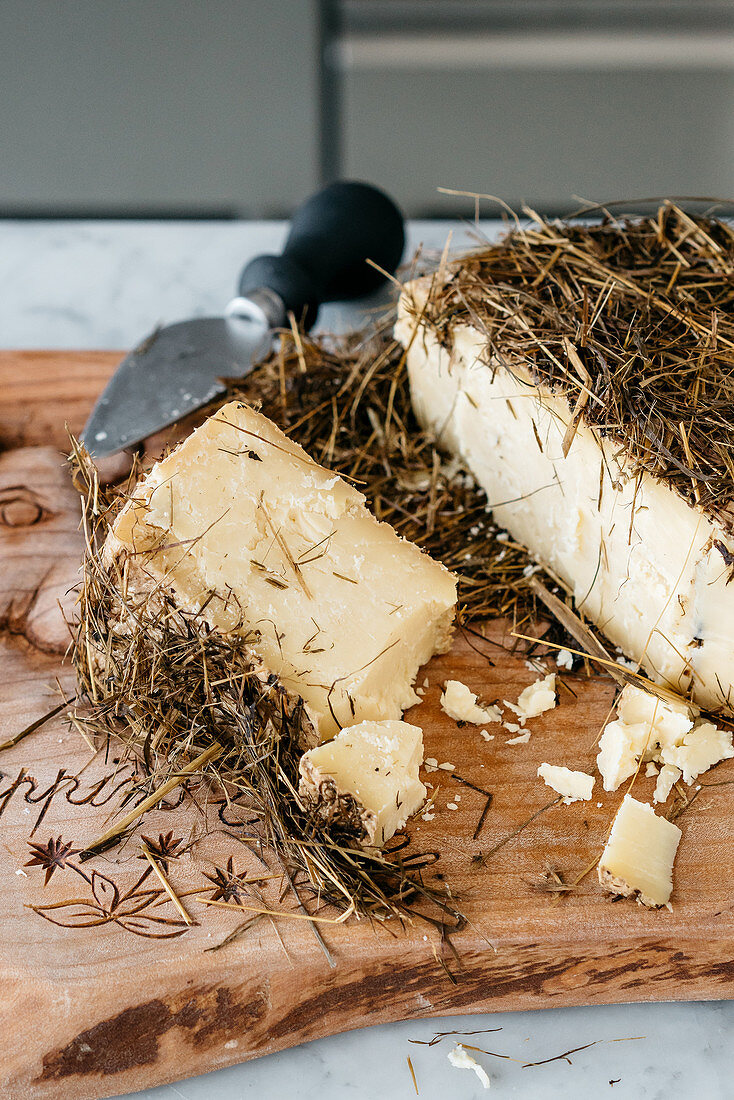 Occelli cheese with a hay coating