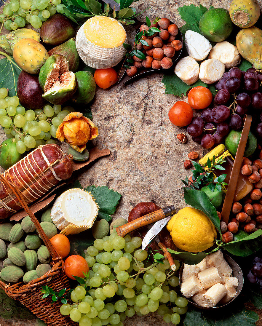 An arrangement of fruits, cheese and sausage from Corsica
