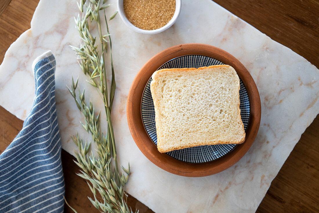 A slice of toast and cane sugar
