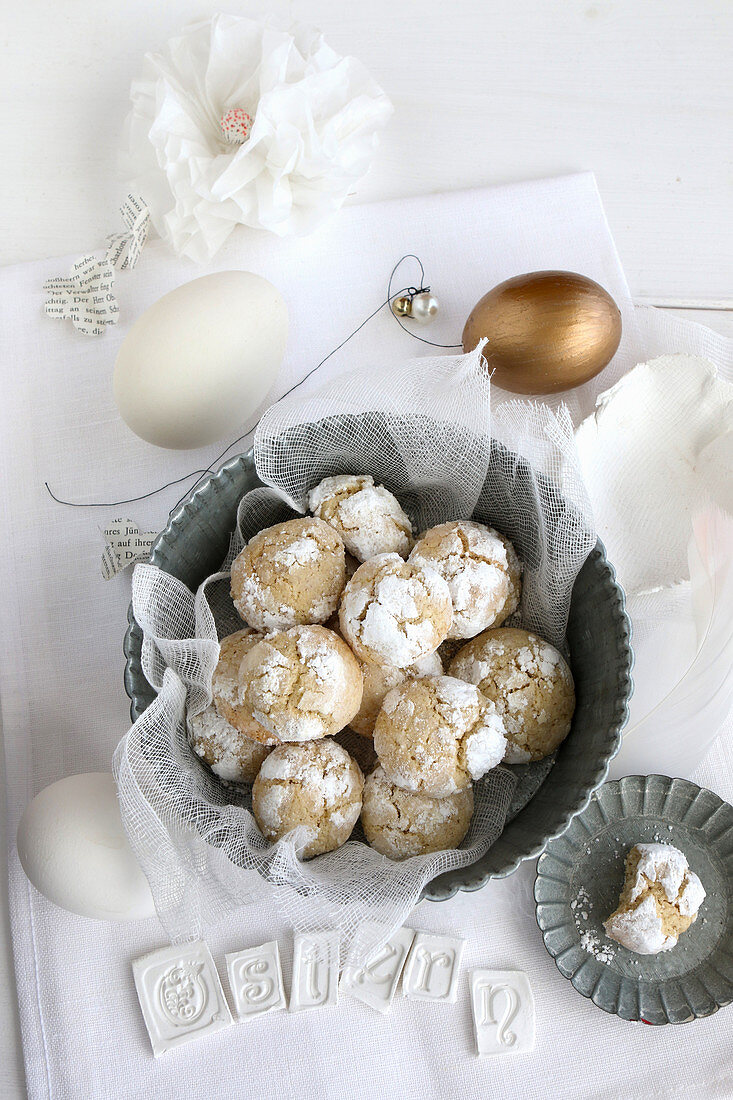 Gluten-free lemon biscotti with icing sugar for Easter