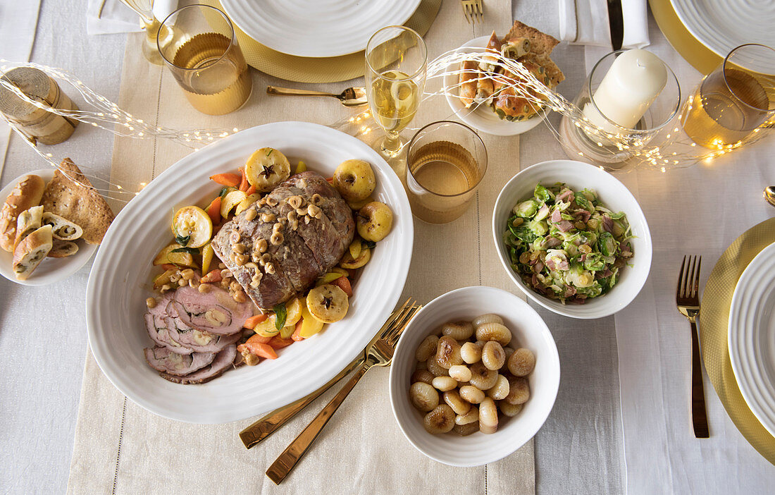 Roast Christmas dinner with sides on a festively laid table