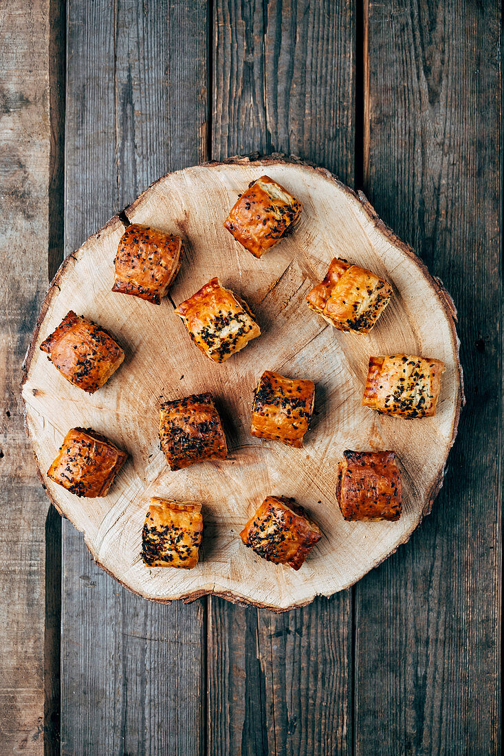 Pork sausage rolls with a paprike flake topping
