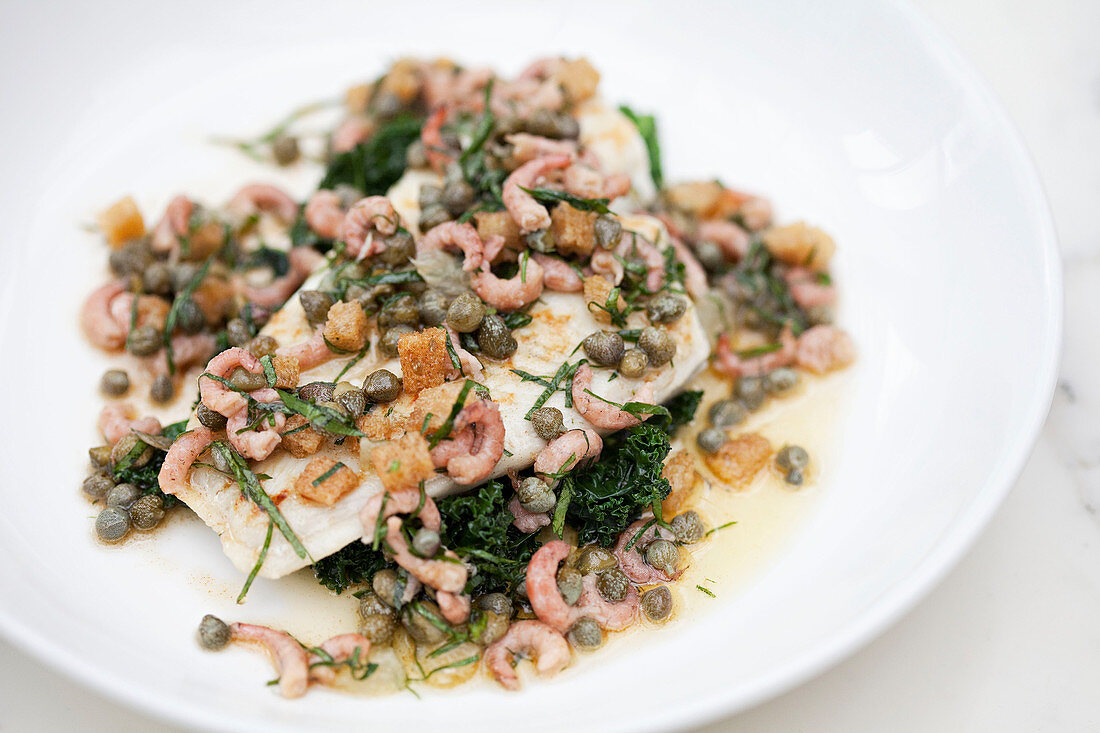 Skate wing with freshwater prawns, brownbutter, capers and a lemon wedge