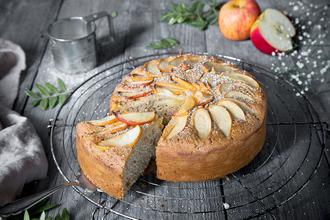 Wholemeal apple cake, slice, on a wire rack