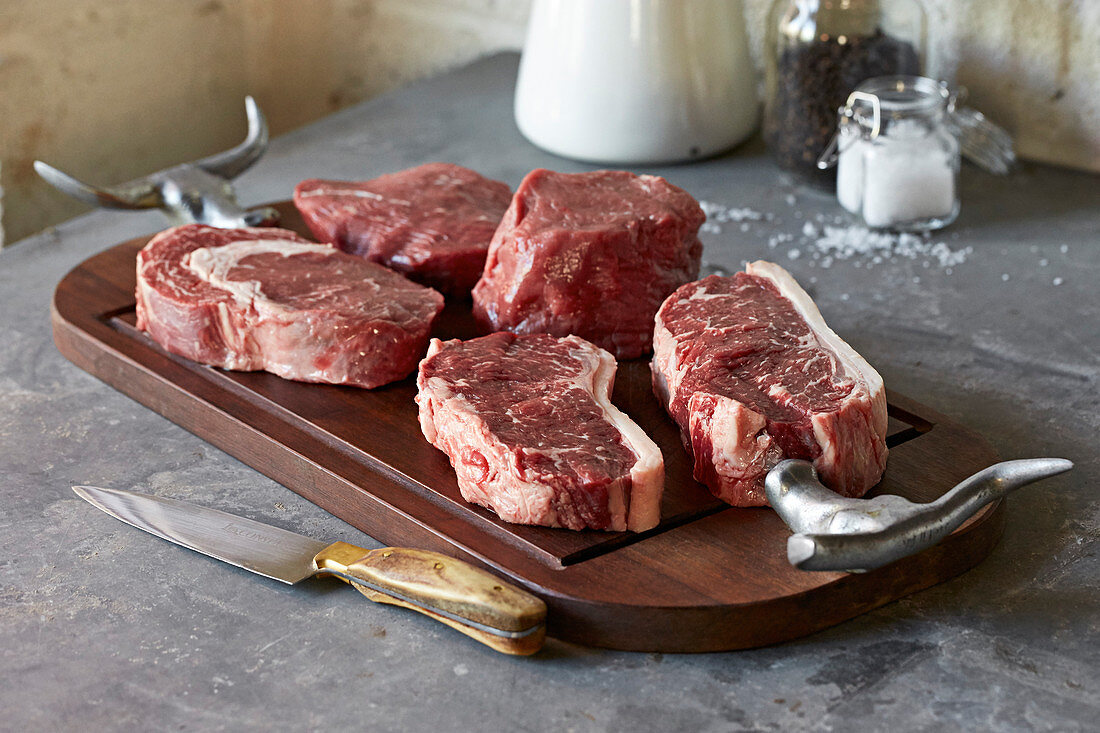An assortment of steak cuts on a tray
