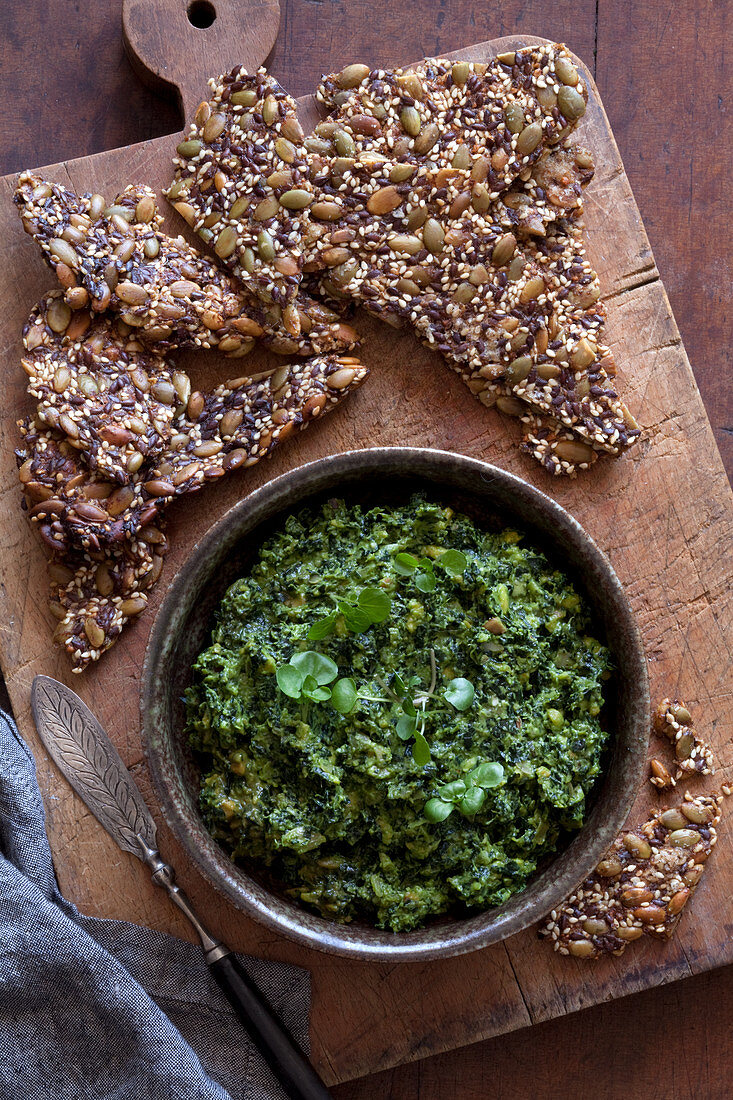 Kale, avocado and chilli dip with keto crackers