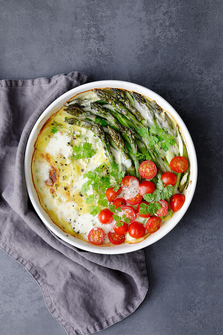 Green asparagus, cherry tomatoes and chervil gratin