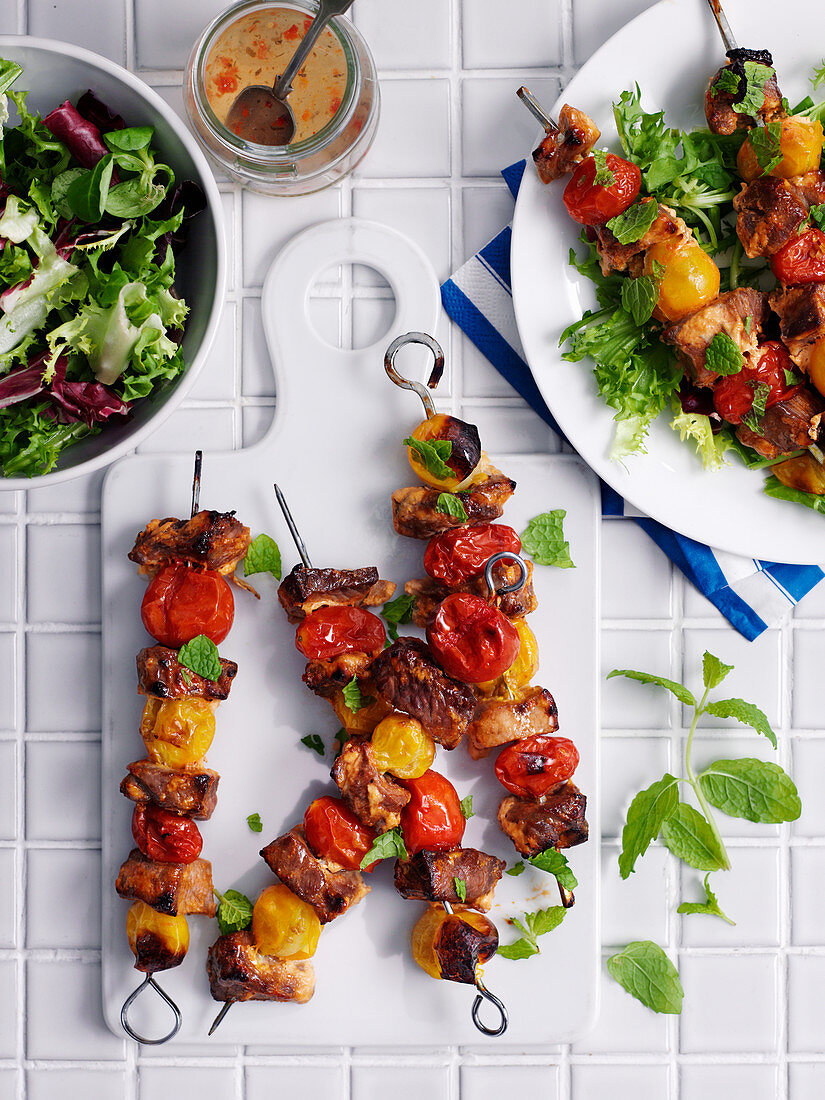 Lamb kebabs with mint and salad