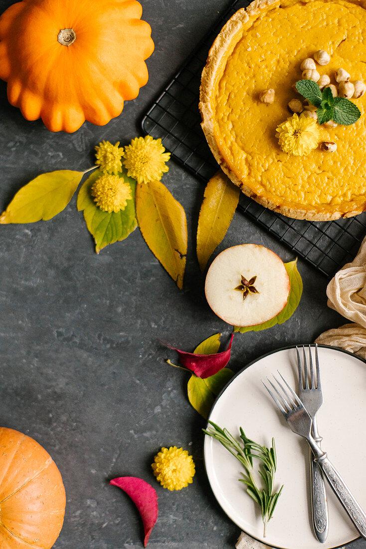 Homemade Pumpkin Pie with Autumn Decoration