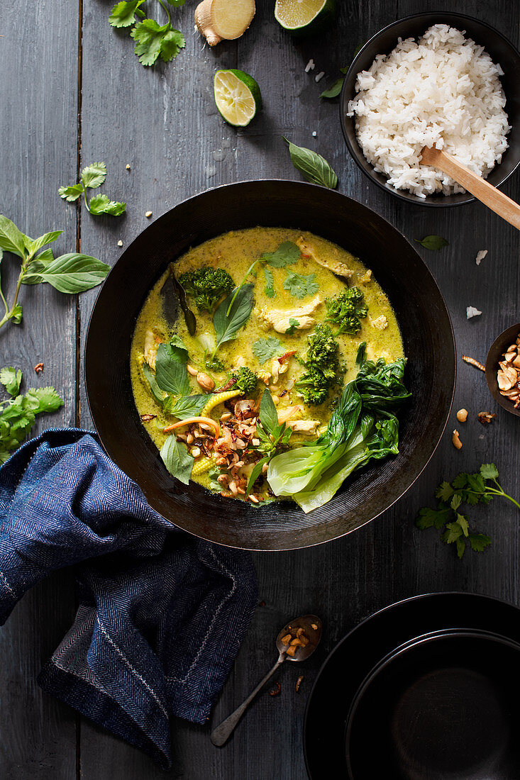 Homemade chicken thai green curry with coriander and thai basil leaves