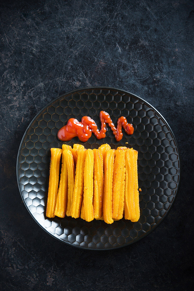 Vegan sweet potato churros with ketchup