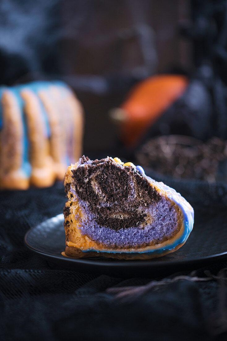 Multi-coloured, vegan sponge cake for Halloween