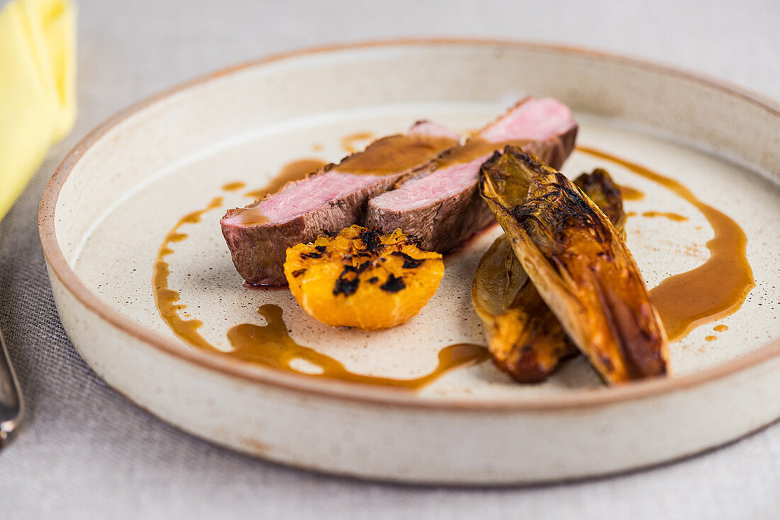 Beef fillet with grilled mandarins and chicory
