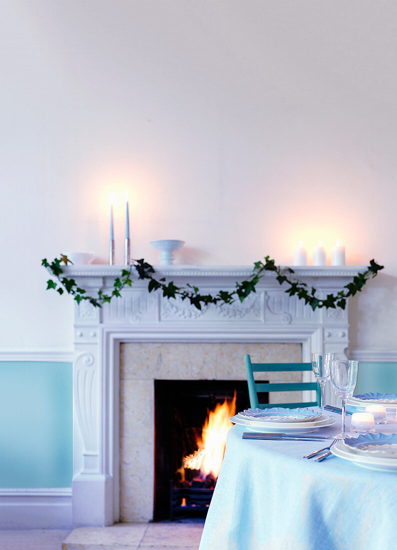 Contemporary cool Christmas table by fireplace