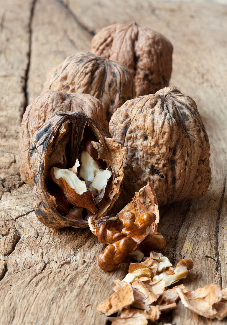Walnuts in shells, with one opened