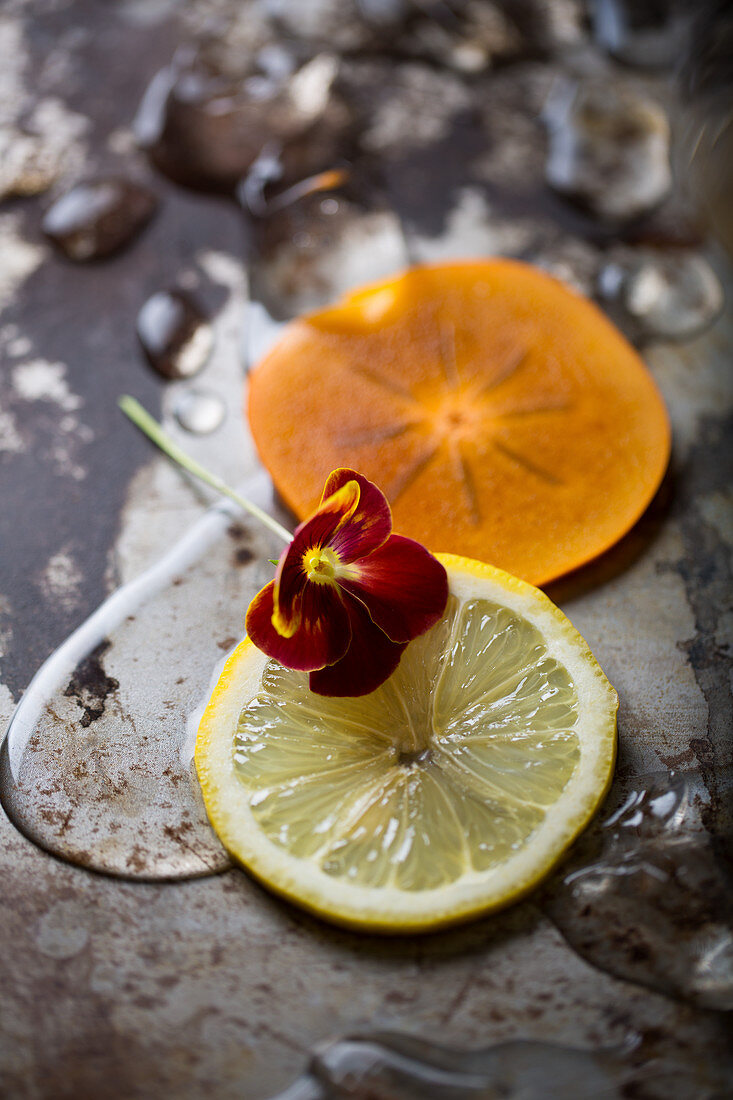 Viola, lemon and persimmon detail with spills and a metallic, rustic background