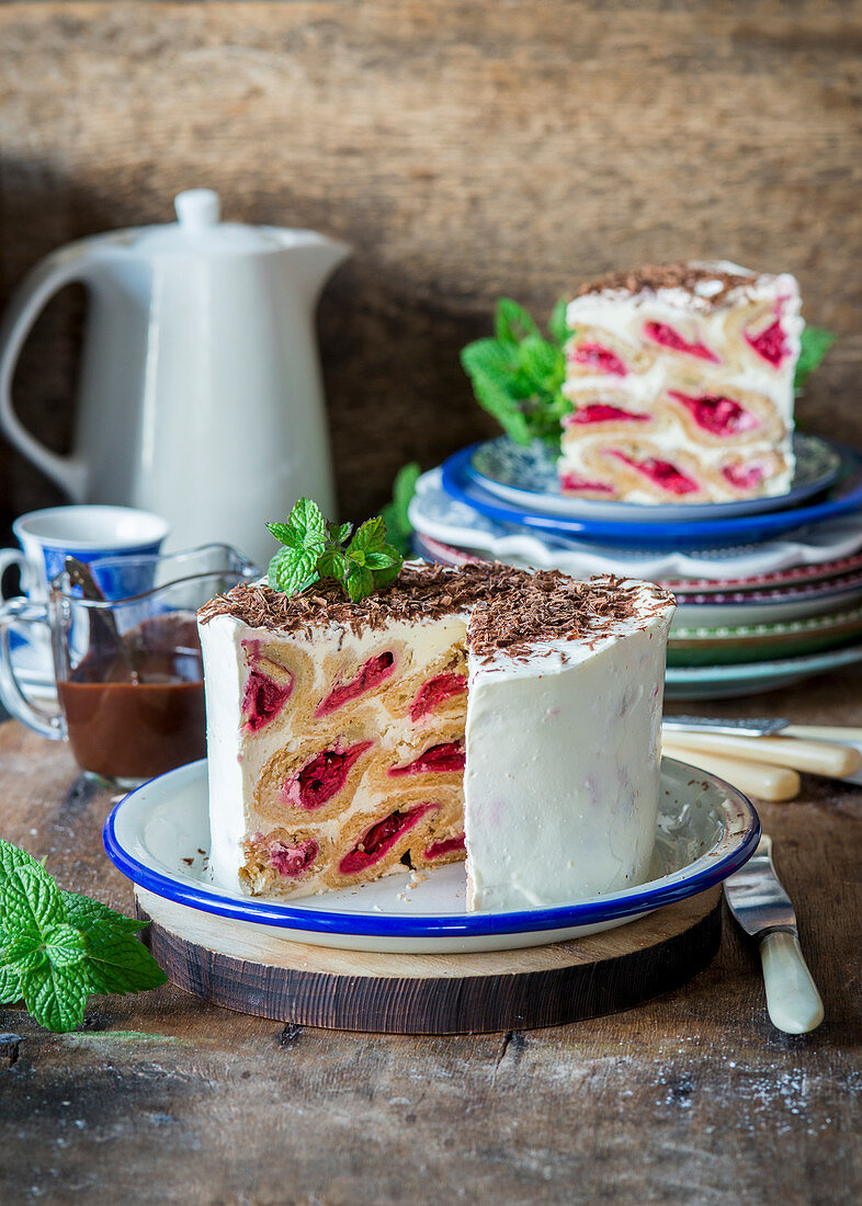 Izba (Russian cake) made with pastry filled with cherries and sour cream