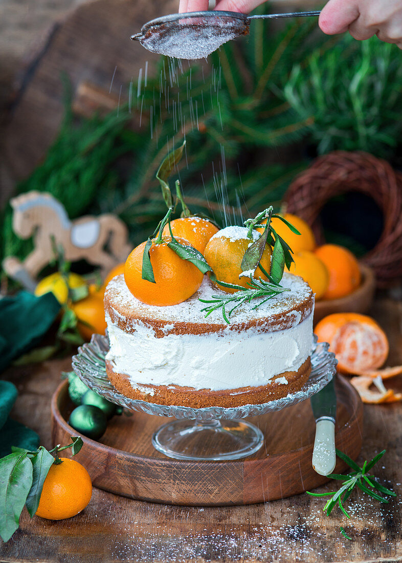 Tangerine cake with zest spiced sponges aand cream cheese
